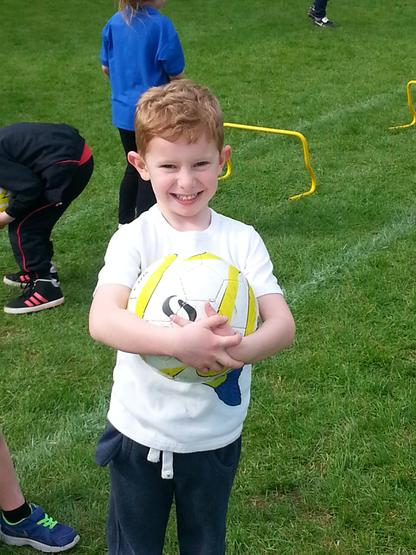 Oliver enjoying infant football club