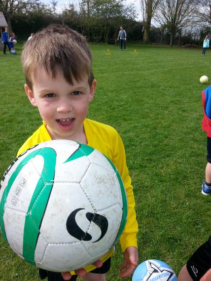 Charlie enjoying infant football club