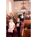 The children enter church