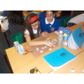 Working together to build our fractions jigsaw.