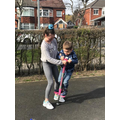 Learning how to jump on a pogo stick.