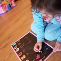 Writing numbers with chalk.