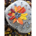 Collect natural materials  and make pictures.