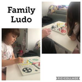 Playing traditional games like ludo.