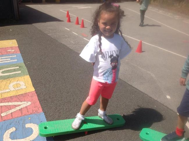 Counting how long we can balance, moving side to side on the balance board!