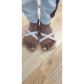 Joshua has made a pair of sandals.