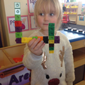 Making numbers with connecting bricks.