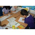 The children busy planning their design.