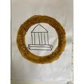 Caitlyn designed a Roman coin.