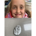 Maggie made a Roman coin using saltdough.