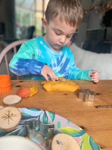 Making shapes with play dough.