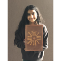 Jaya has made a Roman shield.