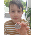 George has made a Roman coin using tinfoil.