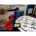 Counting jewels to match with each number.
