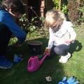 Planting and watering the flowers.