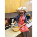 Helping with cooking.