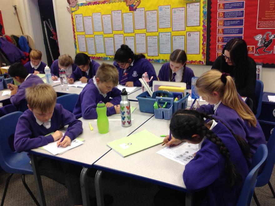 Year 6 learning alongside their teacher.