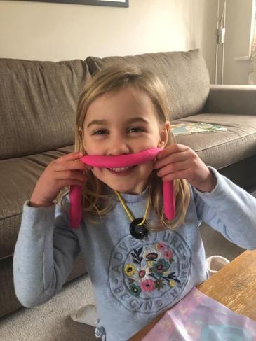 Making mustaches with dough!