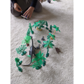 Making up stories with animals and mini world toys
