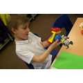 Investigating the moving parts of toys with wheels