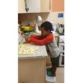 Helping to bake.