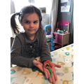 Making flowers and butterflies with dough.