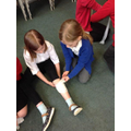 Class 3 learning first aid with Flat Stan.