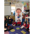 Class 1 learning first aid with Flat Stan.
