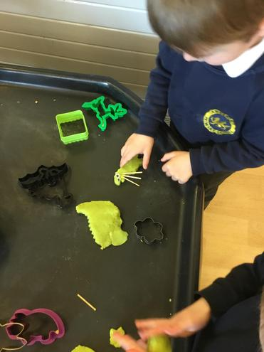 Making creatures out of dough and collage materials.