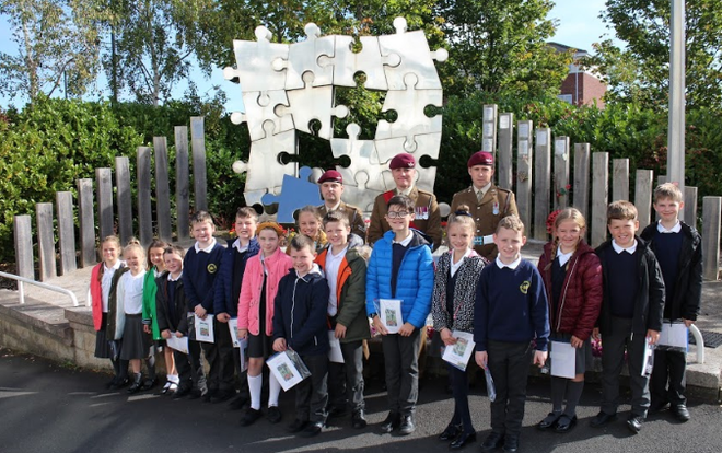 Children showing their respect at a local memorial