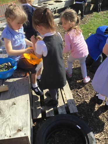 Making cakes in the mud kitchen- yummy!