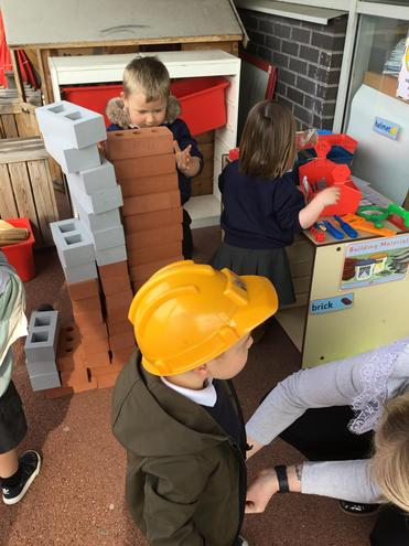 Building a house collaboratively in the builders yard area.