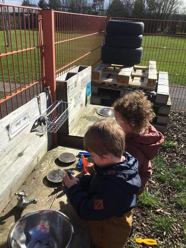 Doing the plumbing and making sure our mud kitchen is in full working order!