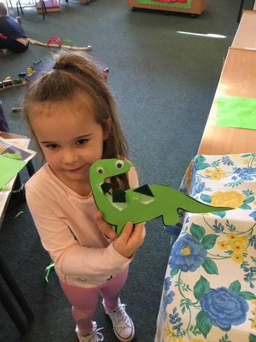 Cutting out and decorating our own dinosaurs.