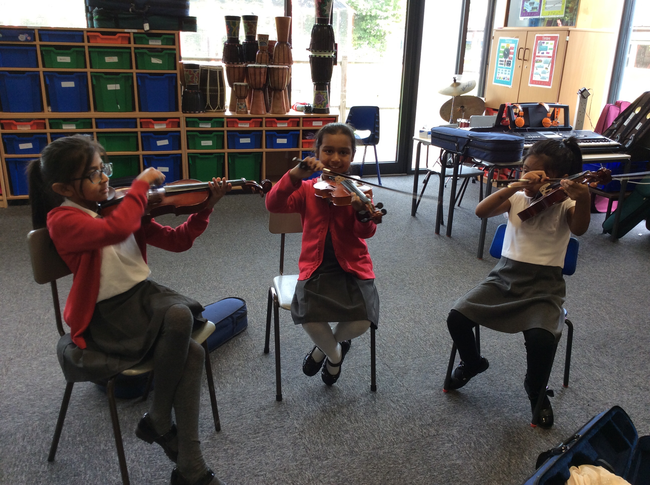 3J Developing their violin skills.
