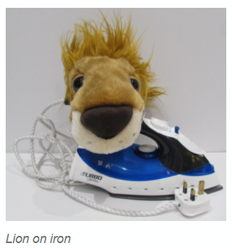 Lions sit on irons.