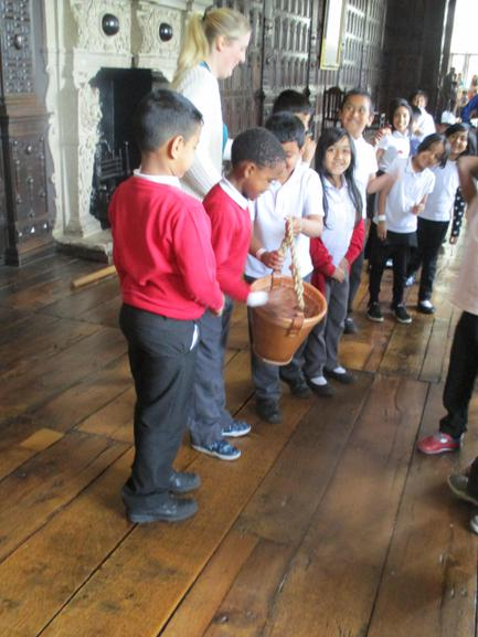 We had a go at passing a leather bucket.