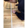 Taking careful measurements.
