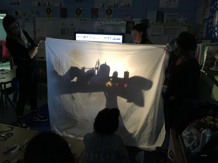 Creating landscape settings with shadow puppets.