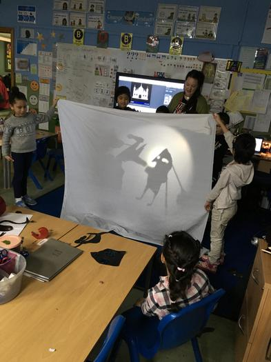 Telling stories with shadow puppets.
