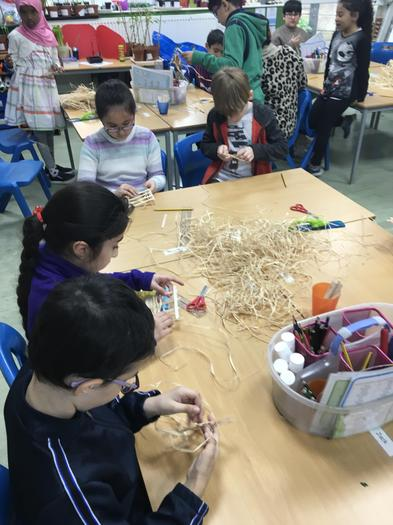 Creating Anglo-Saxon huts with lollipop sticks.