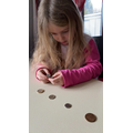Amelia Working On her Coins