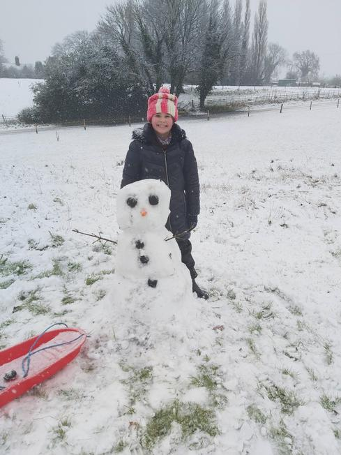 Jessie with her snowman