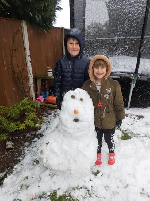Rhys and his sister with their snowman