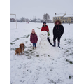 Georgie and her family snowman..