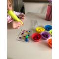 Clara's sorting using her tweezers.