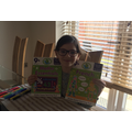 Samantha looking happy with some text books.