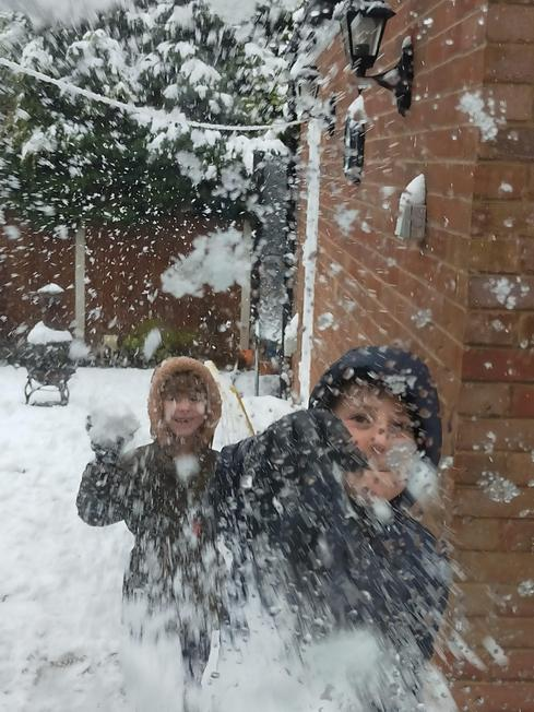 Rhys having a snowball fight