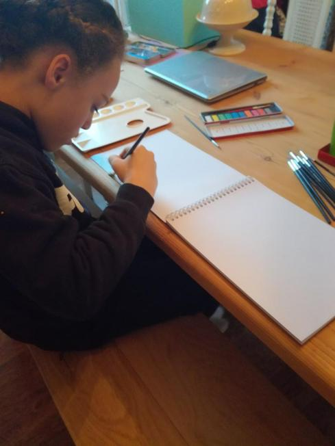 Jacob trying his hand at watercolour painting