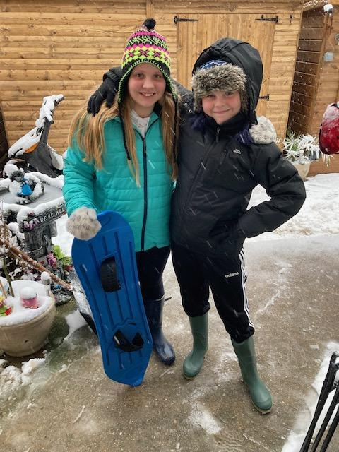 Jacob with his big sister just about to go snowboarding